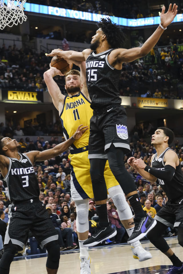 Indiana Pacers forward Domantas Sabonis (11) has his shot blocked by Sacramento Kings forward Marvin Bagley III (35) during the second half of an NBA basketball game in Indianapolis, Friday, Dec. 20, 2019. The Pacers won 119-105. (AP Photo/AJ Mast)