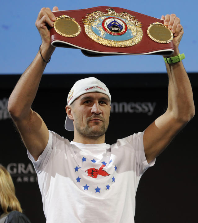 Sergey Kovalev holds up his belt during a news conference Wednesday, Oct. 30, 2019, in Las Vegas. Kovalev is scheduled to fight Canelo Alvarez in a WBO light heavyweight title bout Saturday in Las Vegas. (AP Photo/John Locher)