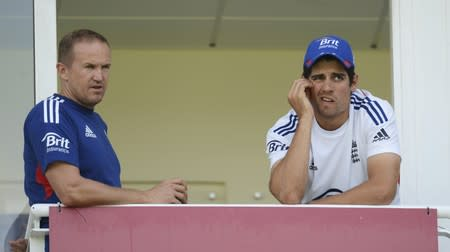 England's Flower talks to Cook after a training session before Wednesday's fifth Ashes cricket test match against Australia at The Oval cricket ground, London