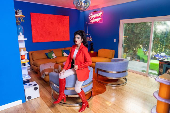 "<div class=""caption""> Words Candice uses to describe her aesthetic: bold, saturated, retro, future, avant-garde, and <a href=""https://www.architecturaldigest.com/story/the-jetsons-space-age-style?mbid=synd_yahoo_rss"" rel=""nofollow noopener"" target=""_blank"" data-ylk=""slk:space age"" class=""link rapid-noclick-resp"">space age</a>. </div>"