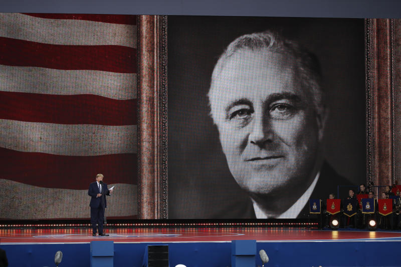 President Donald Trump speaks during a ceremony to mark the 75th Anniversary of D-Day, when the Allied soldiers, sailors and airmen conducted an invasion that helped liberate Europe from Nazi Germany, Wednesday, June 5, 2019, in Portsmouth, England. An image of President Franklin D. Roosevelt is shown, right. (AP Photo/Alex Brandon)