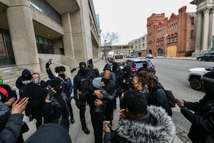 Grandmaster Jay, leader of NFAC, greets members in front of the Hall of Justice on Feb. 26, 2021, in downtown Louisville, Kentucky. Prosecutors say he aimed a rifle at law enforcement officers who were conducting surveillance on the evening of Sept. 4, 2020. He faces two federal charges.