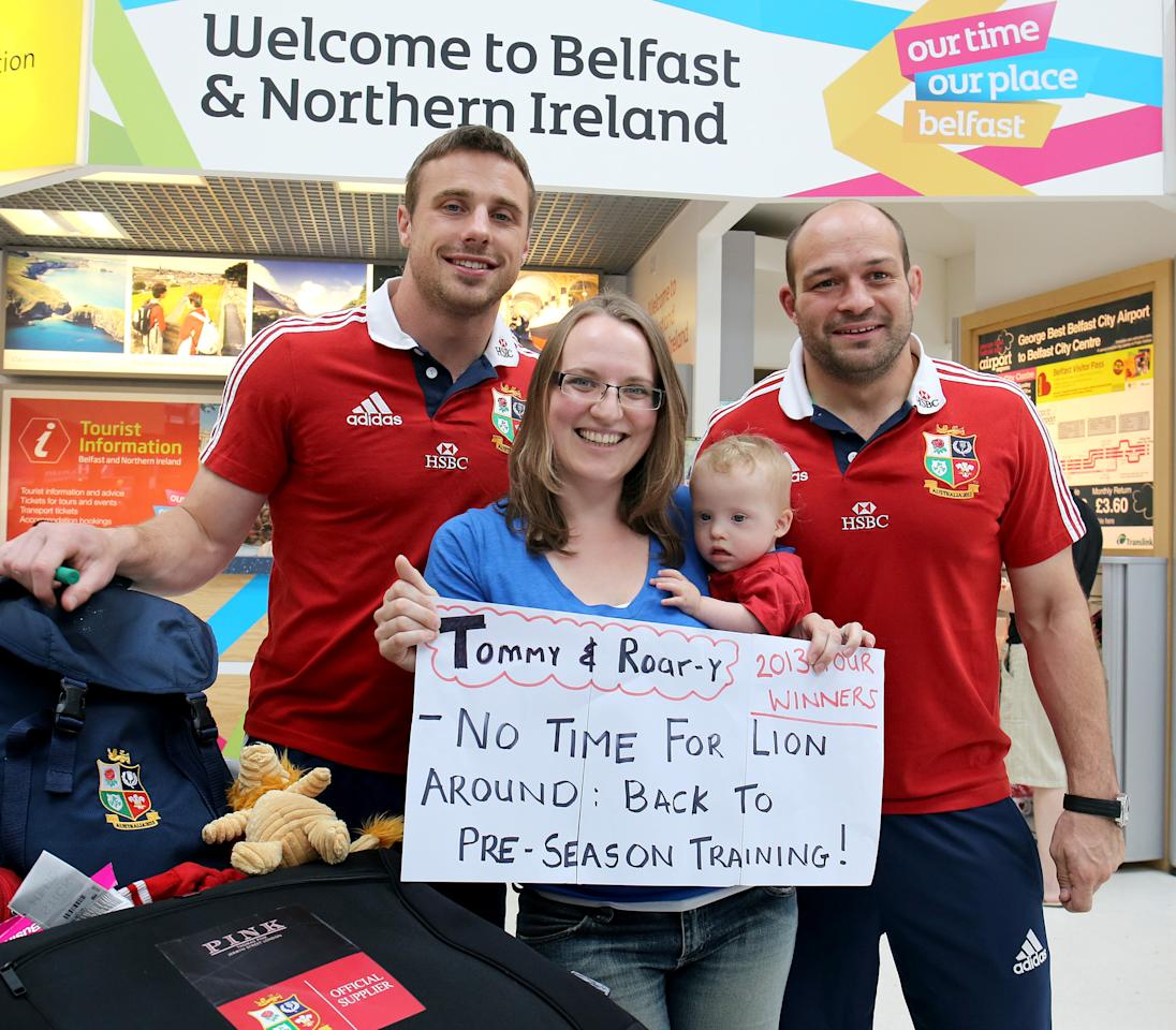 British and Irish Lions' Tommy Bowe (left) and Rory Best are welcomed back home at George Best Belfast City Airport, by fan Nicola Woods with her son Daniel,10 months at George Best Belfast City airport following their series win over Australia. ASSOCIATION Photo. Picture date: Wednesday July 10, 2013. See PA story RUGBYU Lions. Photo credit should read: Paul Faith/PA Wire.