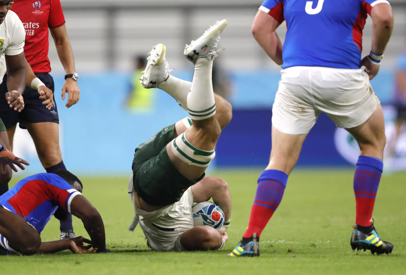 South Africa's Kwagga Smith falls after he was tackled during the Rugby World Cup Pool B game at the City of Toyota Stadium between South Africa and Namibia in Toyota City, Japan, Saturday, Sept. 28, 2019. (AP Photo/Christophe Ena)
