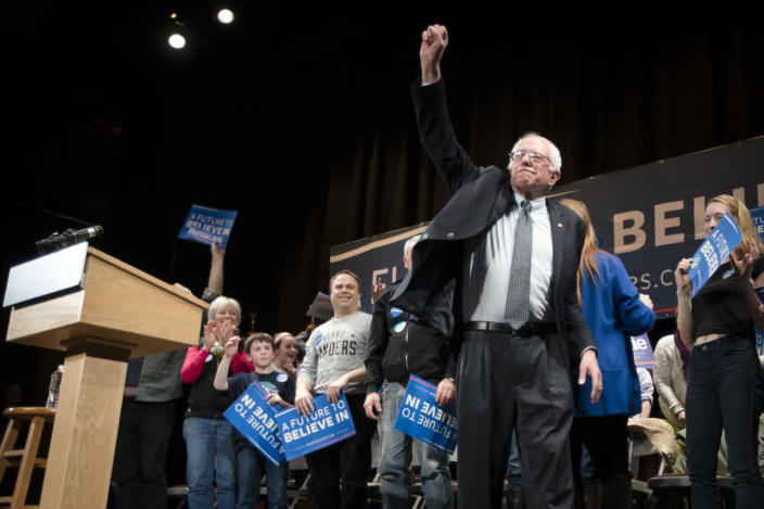 <p>Sanders raises an optimistic fist after speaking at the Claremont Opera House, Tuesday, Feb. 2, 2016, in Claremont, N.H.<i> (Photo: John Minchillo/AP)</i></p>