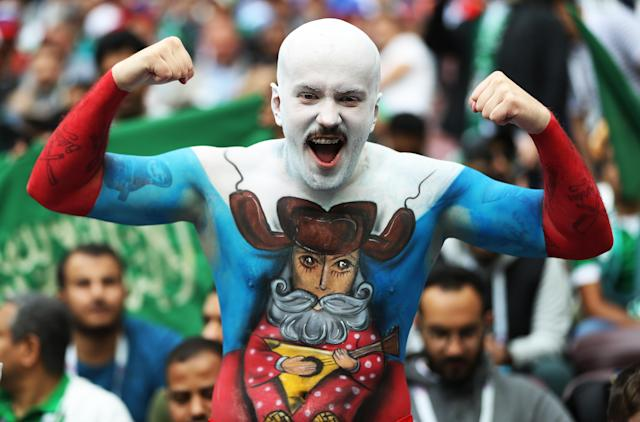 <p>Dedicated: A Russian fan in the build-up to the big kick off. (PA) </p>