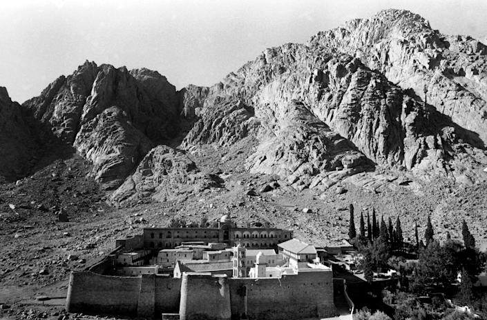 FILE - In this Oct. 26, 1979 file photo, St. Catherine's Monastery is seen from one of the mountains neighboring Mount Sinai in Egypt. Egyptian security officials said Monday that they will not give in to the demands of a Bedouin man who took hostage two Americans and their local translator, now entering their fourth day in captivity. Boston-area residents Pentecostal Rev. Michel Louis, 61, and 39-year-old Lissa Alphonse were taken off a bus Friday with their Egyptian tour guide on a road in the Sinai Peninsula. The two Americans were on a Holy Land tour heading from Cairo to the sixth-century St. Catherine's Monastery, located at the foot of Mount Sinai where the Old Testament says Moses received the stone tablets with the Ten Commandments. (AP Photo/Rina Castelnuovo, File)