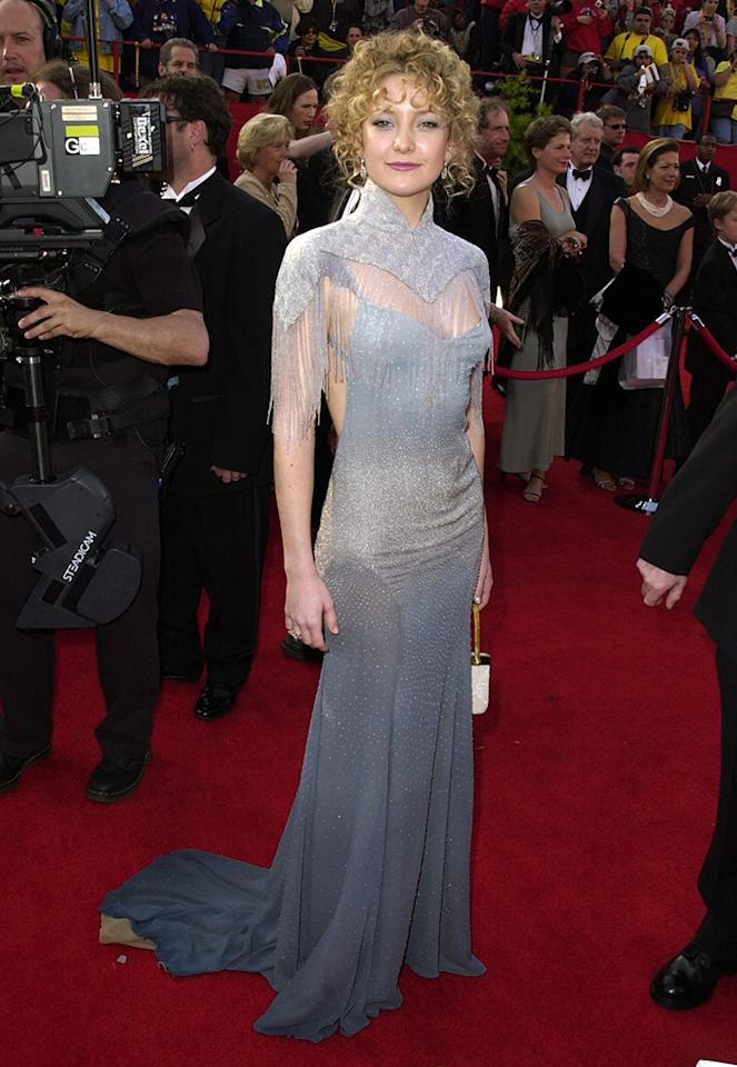 "Kate Hudson, 2001. Sweet Kate. Lovely Kate. The daughter of a famous parent (Goldie Hawn) donned the design of another daughter of a famous parent (Stella and Paul McCartney), a shimmery gray number that whispered sexy Victorian grandma -- or was it Edwardian? Anyhow, it ended up widely ridiculed, and Hudson went from feeling like the "" hippest, coolest girl in the world "" to, well, laughing her ""arse"" off with Stella, who blamed Hudson's hairstyle. She had a point."