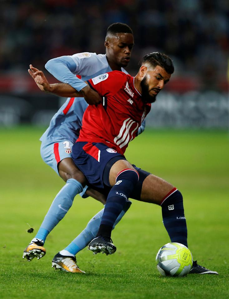 Soccer Football - Ligue 1 - LOSC Lille vs AS Monaco - Stade Pierre-Mauroy, Lille, France - September 22, 2017   Monaco's Adama Diakhaby in action with Lille's Fares Bahlouli        REUTERS/Pascal Rossignol