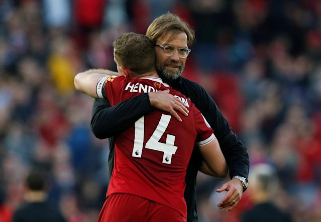 "Soccer Football - Premier League - Liverpool vs AFC Bournemouth - Anfield, Liverpool, Britain - April 14, 2018 Liverpool manager Juergen Klopp and Jordan Henderson celebrate after the match REUTERS/Andrew Yates EDITORIAL USE ONLY. No use with unauthorized audio, video, data, fixture lists, club/league logos or ""live"" services. Online in-match use limited to 75 images, no video emulation. No use in betting, games or single club/league/player publications. Please contact your account representative for further details."