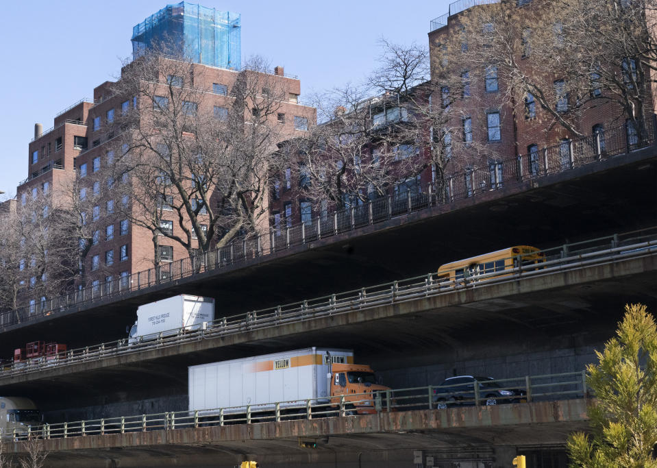 Vehicles drive along the Brooklyn Queens Expressway, part of the city's aging infrastructure, beneath the Brooklyn Heights promenade, Tuesday, April 6, 2021, in New York. With an appeal to think big, President Joe Biden is promoting his $2.3 trillion infrastructure plan directly to Americans. Republicans oppose Biden's American Jobs Plan as big taxes, big spending and big government. (AP Photo/Mark Lennihan)