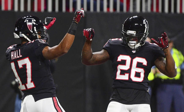 Atlanta Falcons wide receiver Marvin Hall (17) celebrates his touchdown with Atlanta Falcons running back Tevin Coleman during the first half of an NFL football game against the New York Giants, Monday, Oct. 22, 2018, in Atlanta. (AP Photo/John Amis)