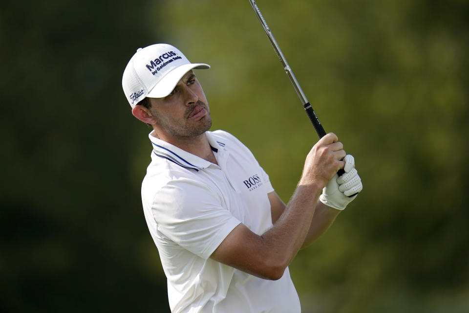 Patrick Cantlay tees off on the 12th hole during the first round of the BMW Championship golf tournament, Thursday, Aug. 26, 2021, at Caves Valley Golf Club in Owings Mills, Md. (AP Photo/Julio Cortez)
