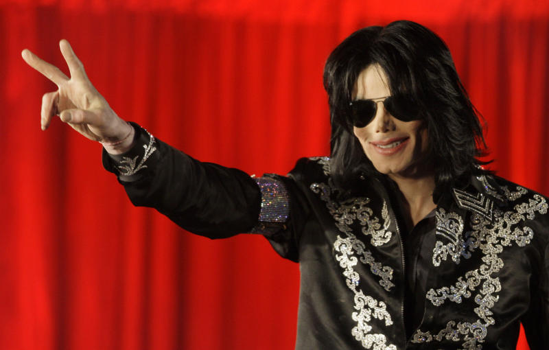 ** FILE ** In this March 5, 2009 file photo US singer Michael Jackson announces that he is set to play ten live concerts at the London O2 Arena in July, which he announced at a press conference at the London O2 Arena. A federal judge ruled in favor of Jackson's estate Friday Aug. 10, 2012 that a businessman who operated a website using the likeness and some of the singer's works had infringed copyrights and should be blocked from future usage of the material. (AP Photo/Joel Ryan, File)