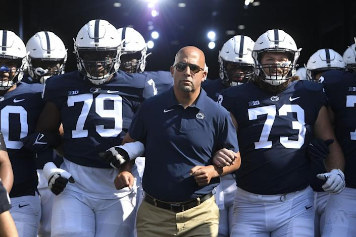 Penn State coach James Franklin walks with his players onto the field before a game against Ball State on Sept. 11.
