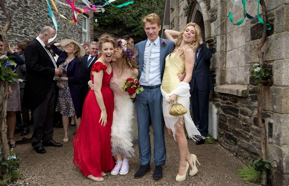 <p>Mary (played by Rachel McAdams) wears a red (red!) wedding dress to marry Tim (played by Domhnall Gleeson) and honestly, I'm a sucker for an edgy fashion move.</p>