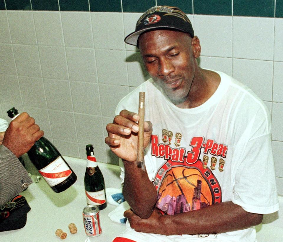 Michael Jordan's love of fine cigars is well-documented. (Photo credit should read MIKE NELSON/AFP via Getty Images)