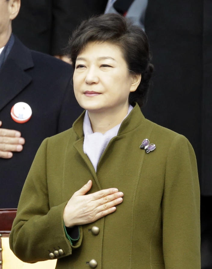 South Korean President Park Geun-hye salutes the national flag during her inauguration ceremony at the National Assembly in Seoul, South Korea, Monday, Feb. 25, 2013. Park became South Korea's first female president Monday, returning to the presidential mansion where she grew up with her dictator father. (AP Photo/Lee Jin-man)