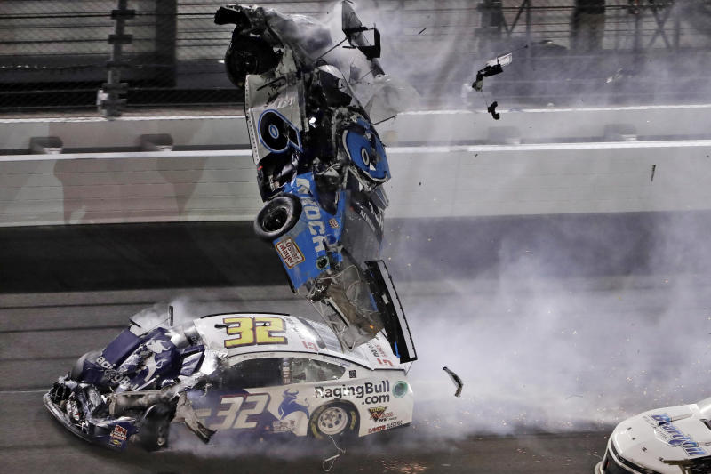 Ryan Newman (6) goes airborne after crashing into Corey LaJoie (32) during the NASCAR Daytona 500 auto race Monday, Feb. 17, 2020, at Daytona International Speedway in Daytona Beach, Fla. Newman did not suffer life-threatening injuries in the incident. (AP Photo/Chris O'Meara)