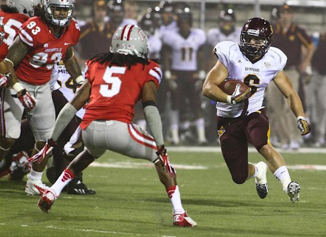 Central Michigan's Jordan Fields (6) looks to run past UNLV's Frank Crawford (5) during the first half of an NCAA college football game at Sam Boyd Stadium in Las Vegas on Saturday, Sept. 14, 2013. (AP Photo/Las Vegas Review-Journal, Chase Stevens)