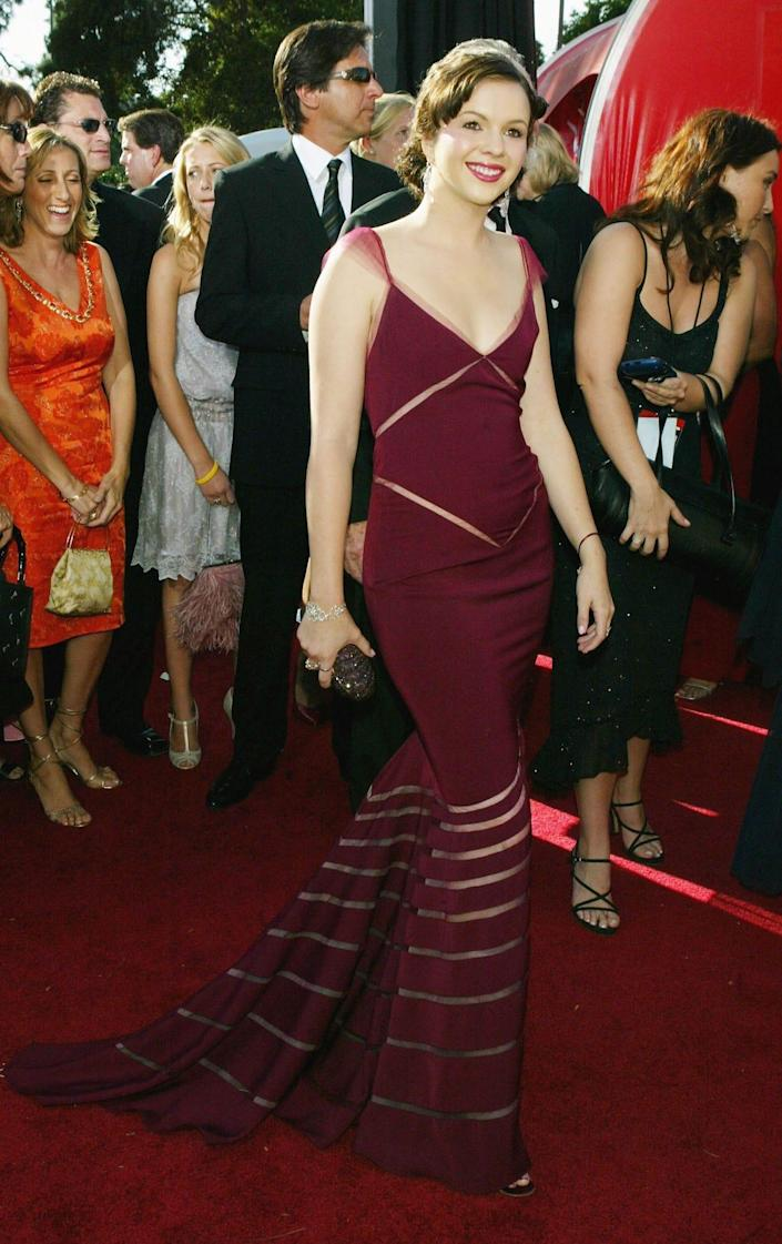 Amber Tamblyn wears a maroon dress at the Emmys in 2004.