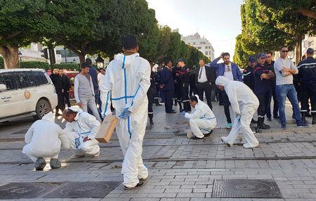 Forensic experts work near the site of an explosion in the center of the Tunisian capital Tunis, Tunisia October 29, 2018. REUTERS/Tarek Amara
