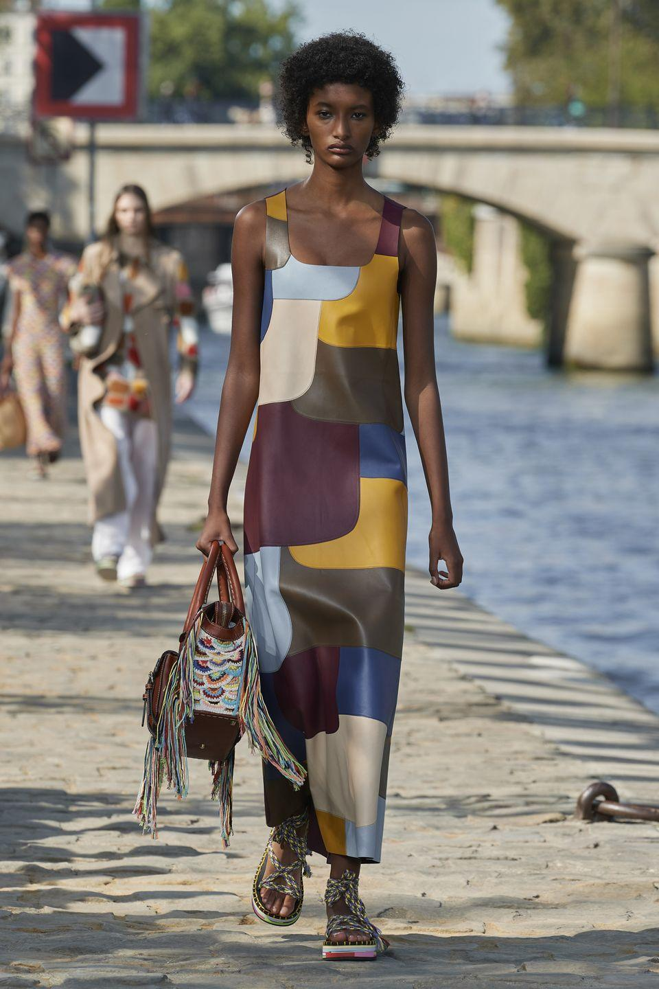 """<p>Leading the show notes for Chloé's spring/summer 2022 collection was a quote from Aldous Huxley about love.</p><p>""""Of all the worn, smudged, dog-eared words in our vocabulary, 'love' is surely the grubbiest, smelliest, slimiest. Bawled from a<br>million pulpits, lasciviously crooned through hundreds of millions of loudspeakers, it has become an outrage to good taste and decent<br>feeling, an obscenity which one hesitates to pronounce. And yet it has to be pronounced; for, after all, Love is the last word.""""</p><p>As well as the concept of love inspiring the collection was a celebration of craft, where it is expanding the number of our products handcrafted by independent artisans. </p><p>""""We are embossing all of these products with a signature spiral<br>symbol. Chloé Craft seeks to pioneer new levels of traceability and transparency in the industry and establish a deeper connection between consumers and local producers. These techniques cannot be mimicked by machinery, only mastered by the human hand.""""</p>"""