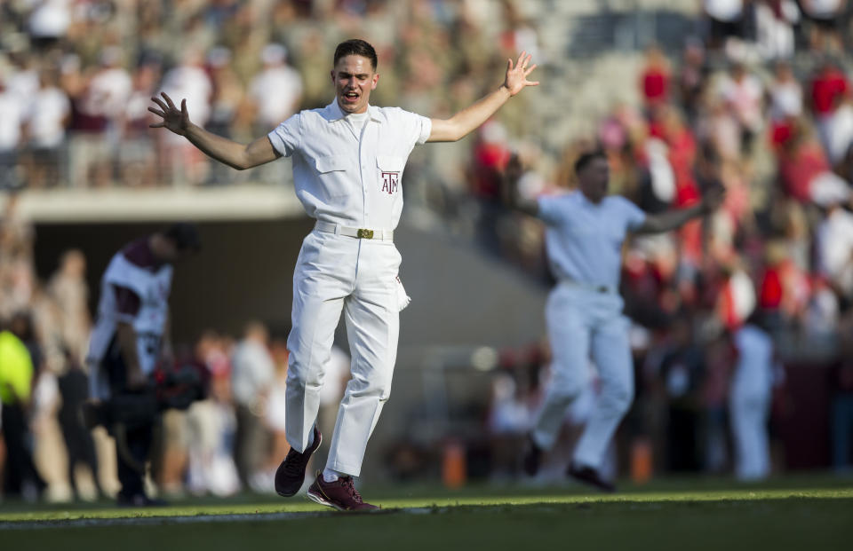 Texas A&M Yell Leaders lead the crowd at Kyle Field in yells before the start of an NCAA college football game Saturday, Sept. 9, 2017, in College Station, Texas. Texas A&M won 24-14. (AP Photo/Sam Craft)