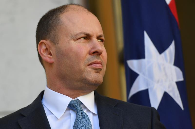 CANBERRA, AUSTRALIA - MARCH 20: Treasurer Josh Frydenberg is seen during a press conference following a Cabinet meeting at Parliament House on March 20, 2020 in Canberra, Australia. Prime minister Scott Morrison has announced further restrictions on indoor gatherings with all non-essential activities in venues including cafes, pubs and clubs, now be subject to a restriction of one person per every four square metres. A travel ban to all visitors who are not Australian citizens or residents or their direct relations arriving into the country will come into effect from 9pm on Friday night for six months. There are now 756 confirmed cases of coronavirus (COVID-19) in Australia while the death toll now stands at seven. (Photo by Sam Mooy/Getty Images)