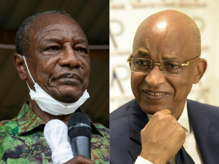 Guinea's President Alpha Conde, left, is seeking to stave off a challenge from his old political opponent Cellou Dalein Diallo
