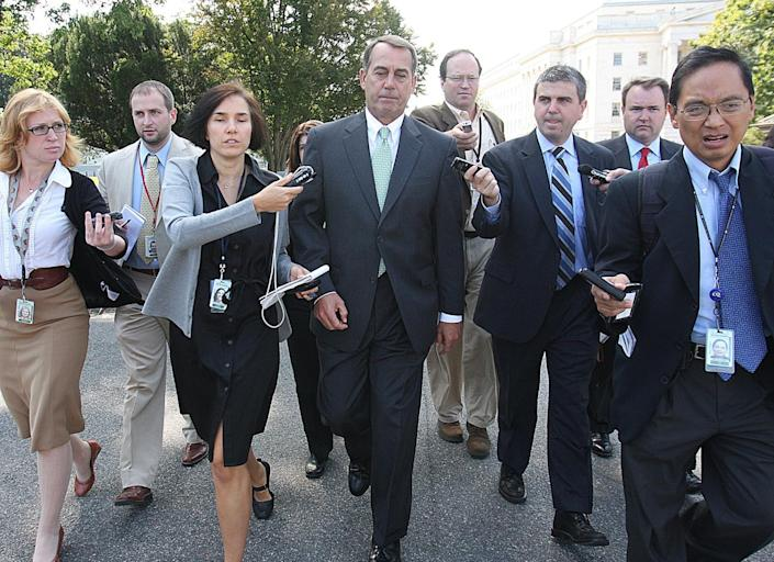 John Boehner, then the House minority leader, is trailed by reporters on Capitol Hill in 2008.