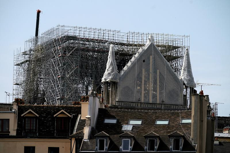 French president Emmanuel Macron promised to complete a painstaking renovation of the gothic masterpiece (AFP Photo/Lionel BONAVENTURE)