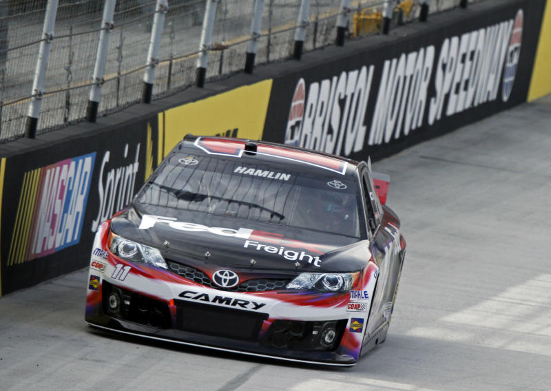Driver Denny Hamlin makes his way around the track during qualifying for the NASCAR Sprint Cup series auto race at Bristol Motor Speedway on Friday, March 14, 2014, in Bristol, Tenn. Hamlin will start on the pole for Sunday's race. (AP Photo/Wade Payne)