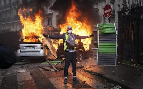 Protesters clashed with riot police on Foch avenue next to the Place de l'Etoile - Credit: Etienne De Malglaive/Getty Images