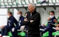 Dortmund coach Lucien Favre watches on from the touchline during a 2-0 win at Wolfsburg