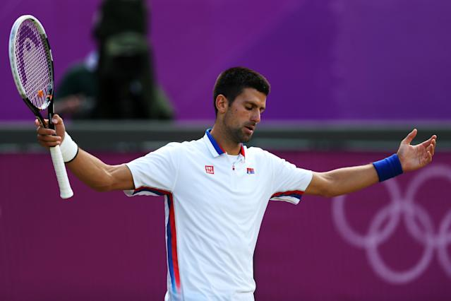LONDON, ENGLAND - AUGUST 05: Novak Djokovic of Serbia reacts during the Men's Singles Tennis Bronze Medal Match against Juan Martin Del Potro of Argentina on Day 9 of the London 2012 Olympic Games at the All England Lawn Tennis and Croquet Club on August 5, 2012 in London, England. (Photo by Julian Finney/Getty Images)