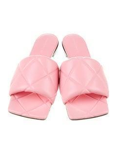 """<br><br><strong>Bottega Veneta</strong> Leather Slides, $, available at <a href=""""https://go.skimresources.com/?id=30283X879131&url=https%3A%2F%2Fwww.therealreal.com%2Fproducts%2Fwomen%2Fshoes%2Fsandals%2Fbottega-veneta-leather-slides-9pco5"""" rel=""""nofollow noopener"""" target=""""_blank"""" data-ylk=""""slk:TheRealReal"""" class=""""link rapid-noclick-resp"""">TheRealReal</a>"""