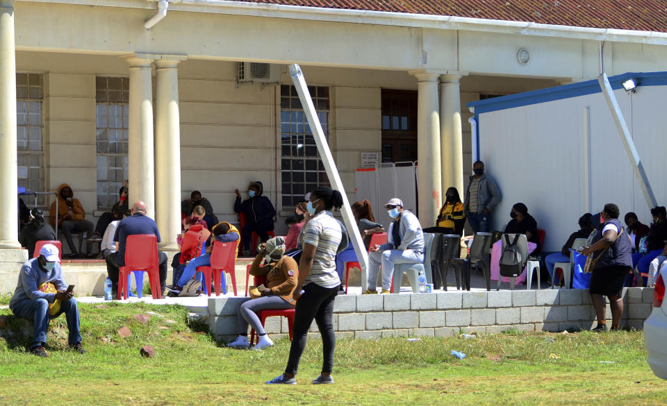 People queue to be tested for COVID-19 at the Livingstone Hospital in Port Elizabeth, South Africa, Friday, Nov. 13, 2020. The African continent has surpassed 2 million confirmed cases as health officials warn of infections starting to creep up again into a second surge. (AP Photo/Theo Jeptha)