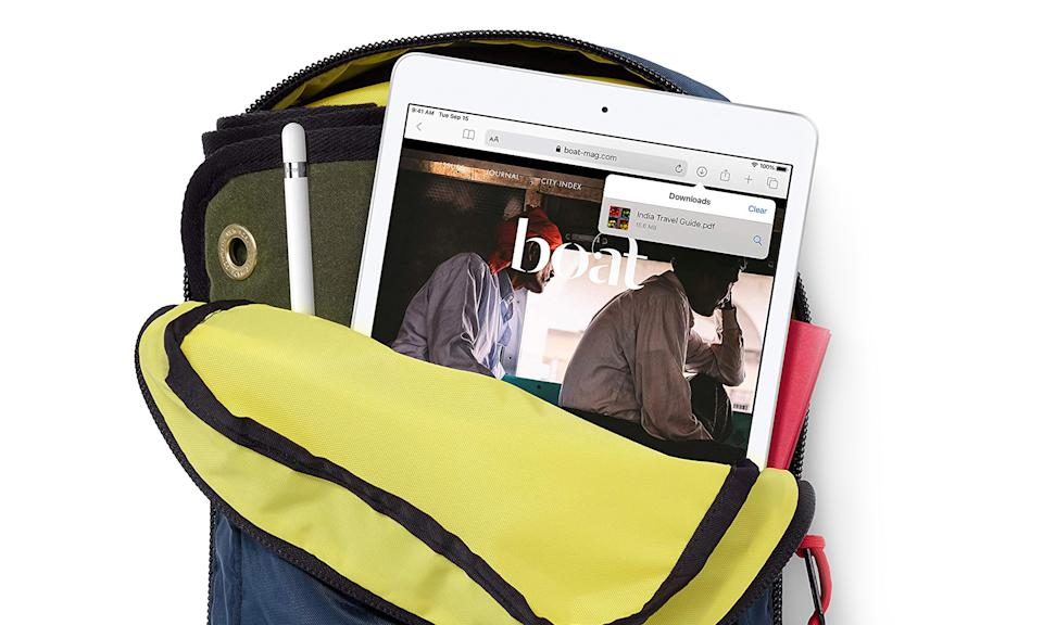 Apple's 10.2-inch iPad sticking out of a crowded backpack.