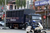 FILE PHOTO: An immigration truck carrying Myanmar migrants to be deported from Malaysia is seen in Lumut