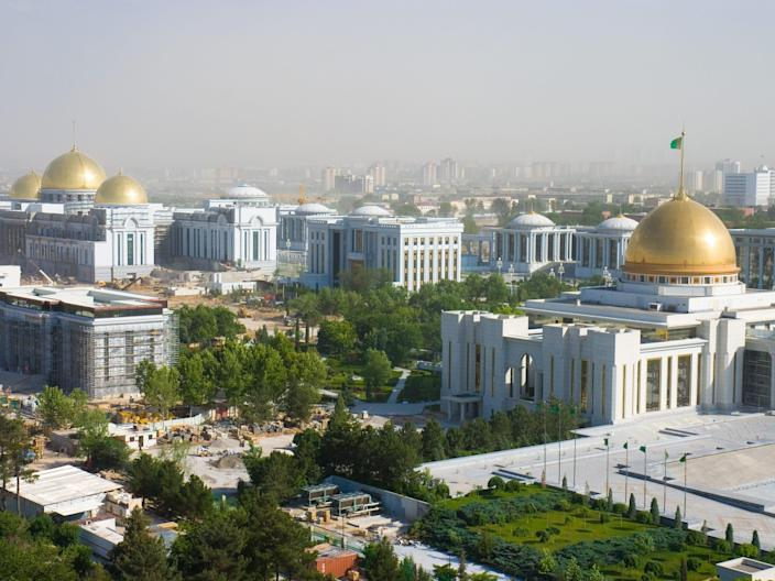 Ashgabat city gleams with sparkling marble buildings.