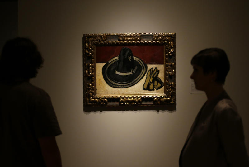 """A painting by Marsden Hartley titled """"Sombrero with Gloves,"""" is viewed during a press preview of the exhibit """"Hotel Texas: An Art Exhibition for the President and Mrs. John F. Kennedy,"""" during a press preview at the Dallas Museum of Art Wednesday, May 22, 2013, in Dallas. (AP Photo/LM Otero)"""