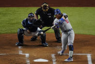 Los Angeles Dodgers' Justin Turner hits home run against the Tampa Bay Rays during the first inning in Game 3 of the baseball World Series Friday, Oct. 23, 2020, in Arlington, Texas. (AP Photo/Sue Ogrocki)