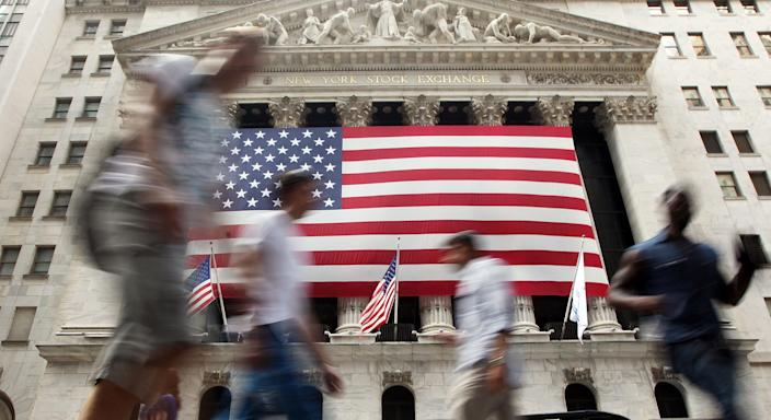 People walk outside the New York Stock Exchange during afternoon trading on August 8, 2011 in New York City. The Dow plunged more than 500 points in afternoon trading after Standard and Poor's downgraded the U.S. credit rating. (Photo by Mario Tama/Getty Images)