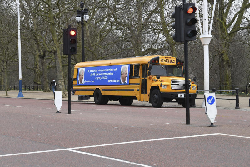 A yellow school bus with a message for the Britain's Prince Andrew, from US lawyer Gloria Allred, on The Mall towards Buckingham Palace in London Friday Feb. 21, 2020. Allred, who represents some of the accusers of Jeffrey Epstein, has been critical of the Prince Andrew for not speaking with the FBI about his former friend Epstein. Epstein died in a New York jail in August 2019 while he was awaiting trial on sex trafficking charges. U.S. authorities ruled the death a suicide. (Stefan Rousseau/PA via AP)