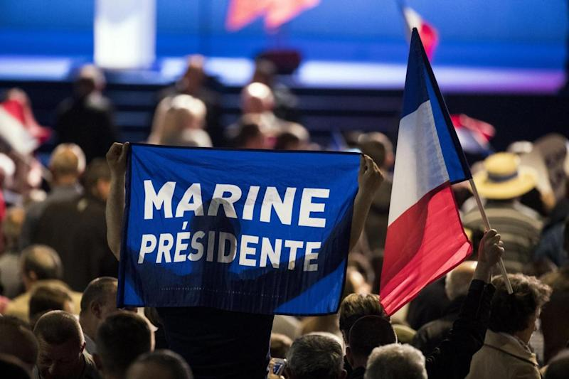 A supporter waves a flag reading 'Marine President' during a march in the north of Paris (EPA)