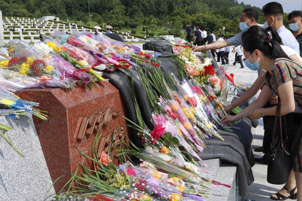 Citizens lay bouquets of flowers at the Fatherland Liberation War Martyrs Cemetery in Pyongyang, North Korea, Tuesday, July 27, 2021, to mark the Korean War armistice anniversary. The leaders of North and South Korea restored suspended communication channels between them and agreed to improve ties, both governments said Tuesday, amid a 2 ½ year-stalemate in U.S.-led diplomacy aimed at stripping North Korea of its nuclear weapons. (AP Photo/Jon Chol Jin)