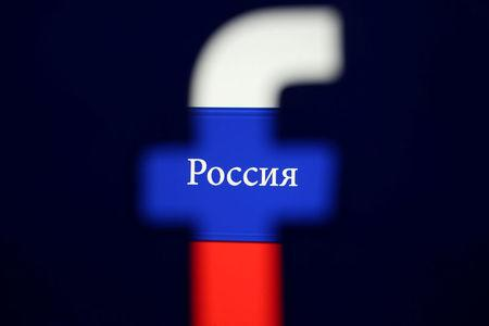 FILE PHOTO: Photo illustration of a 3D printed Facebook logo seen in front of a displayed Russian flag