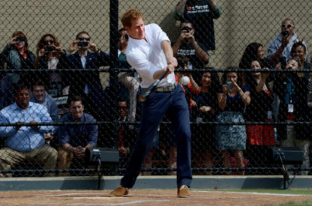NEW YORK, NY - MAY 14: HRH Prince Harry hits a baseball while participating in a baseball clinic during the launch of a new partnership between the Royal Foundation of the Duke and Duchess of Cambridge and Harlem RBI, a local community organization May 14, 2013 in the Harlem neighborhood of New York City. HRH will be undertaking engagements on behalf of charities with which the Prince is closely associated on behalf also of HM Government, with a central theme of supporting injured service personnel from the UK and US forces. (Photo by Justin Lane - Pool/Getty Images)