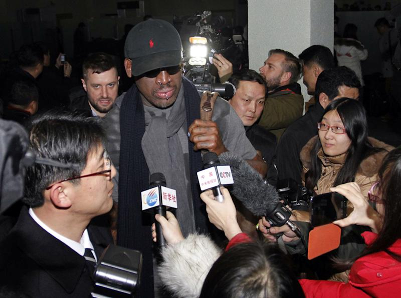 "Flamboyant former NBA star Dennis Rodman is surrounded by journalists upon arrival at Pyongyang Airport, North Korea, Tuesday, Feb. 26, 2013. The American known as ""The Worm"" arrived in Pyongyang, becoming an unlikely ambassador for sports diplomacy at a time of heightened tensions between the U.S. and North Korea. (AP Photo/Kim Kwang Hyon)"